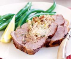 Roast lamb with date and almond stuffing